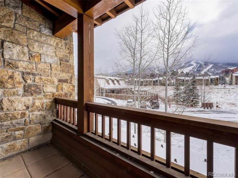 The covered deck offers ski area views.