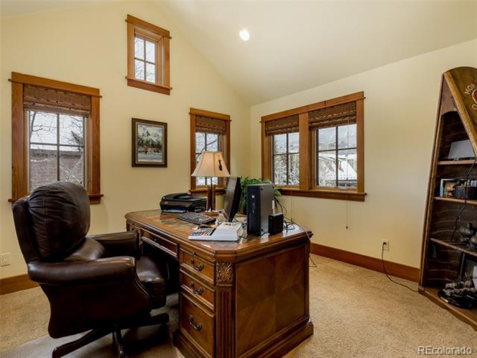 The office/den is light and bright.  It also has an adjacent bath making this a 5th bedroom option.