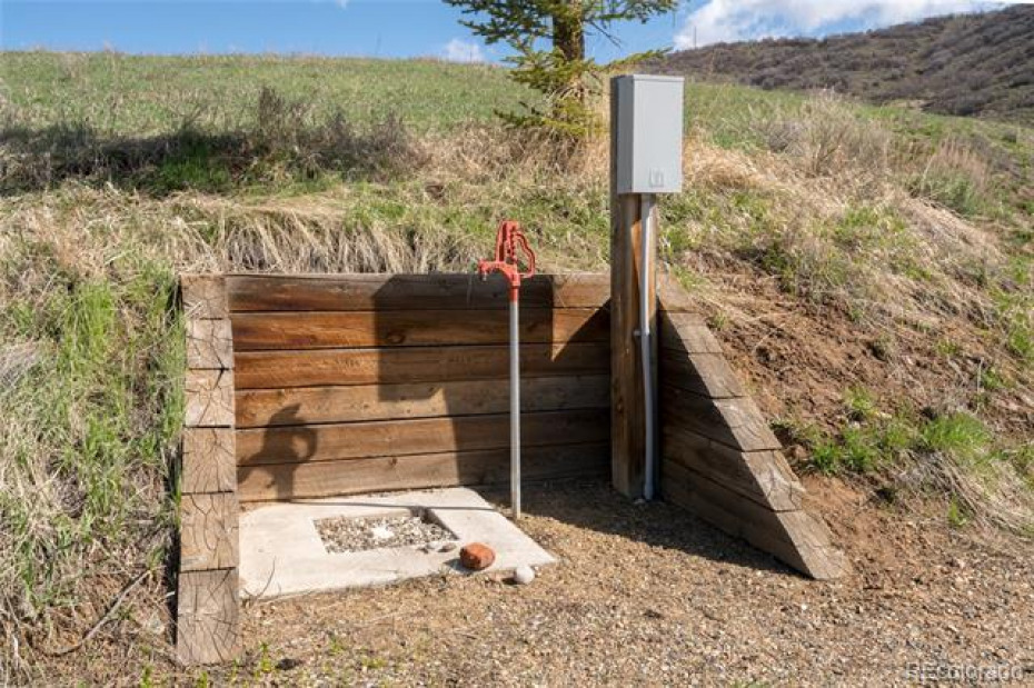 Hookup station for RV with electrical, water, and waste disposal