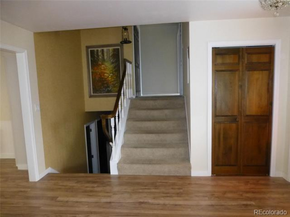 living room with stairs to upper level