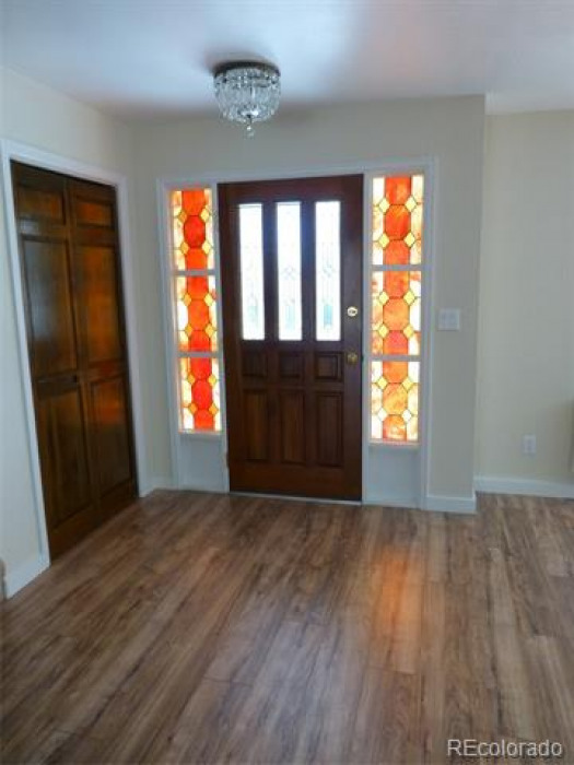 front door with stain glassed side panels