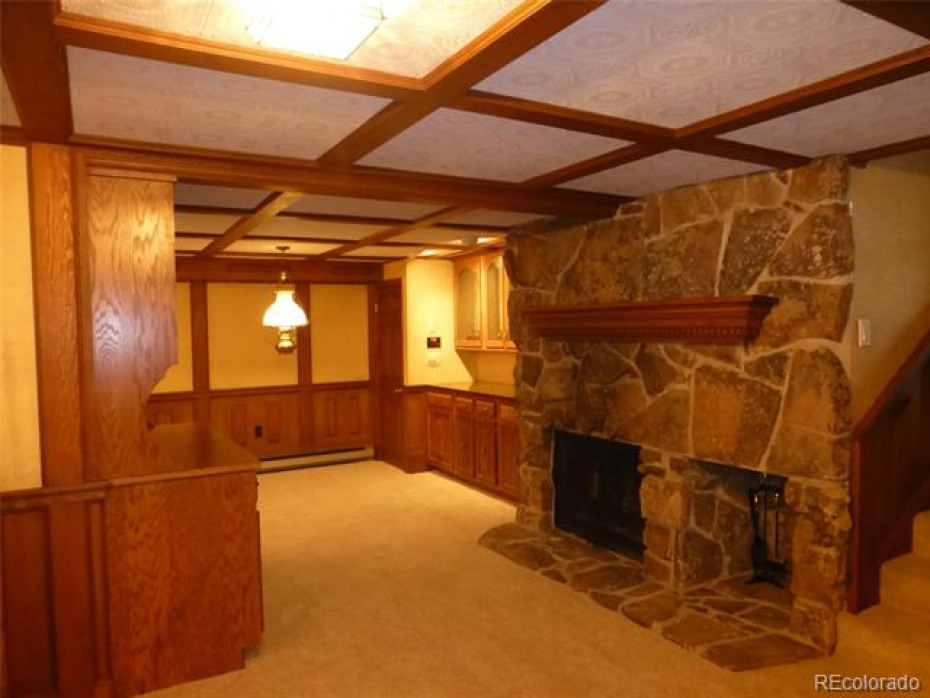 family game/room with wood burning fireplace