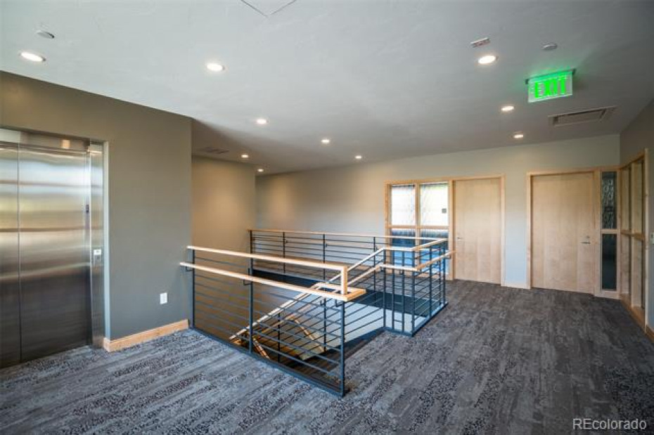 "At the 2nd Floor landing, the entry to Office #203 is to the left (under the ""exit"" sign).  The other door leads to Office #204, which is leased to a general contractor."