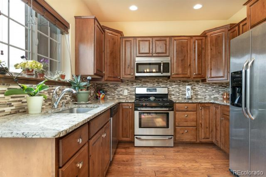 Rich granite counters, alder cabinetry and stainless appliances