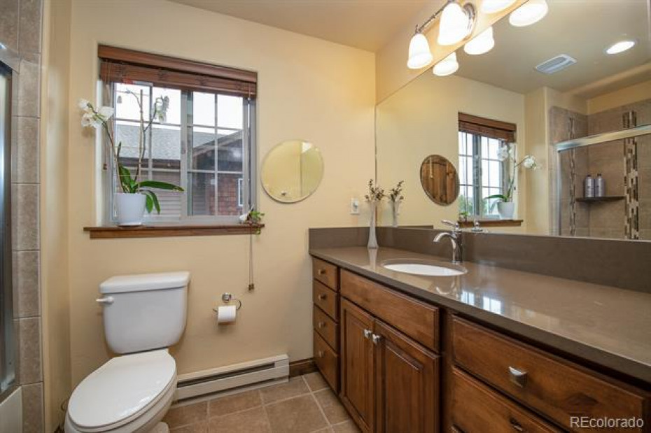 Full Master Bathroom with stunning counters and tilework