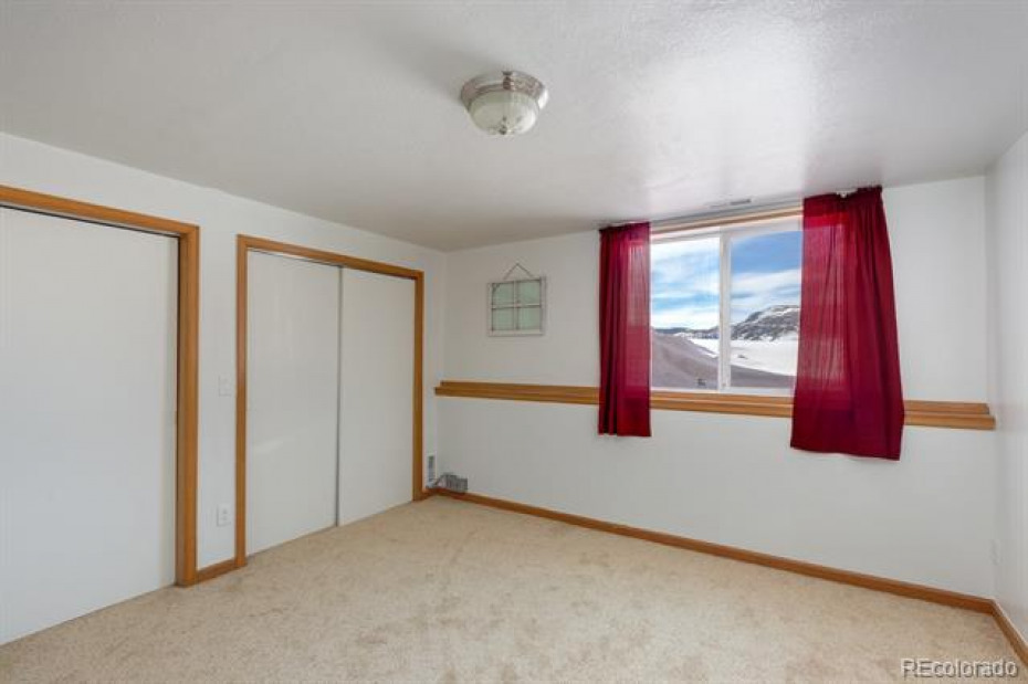 Master bedroom suite, views are abundant from here as well when windows are open.
