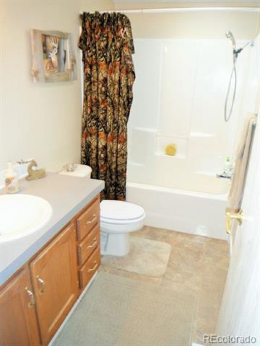 Guest bath on main floor, which also serves as bath for bedrooms #2 and #3.