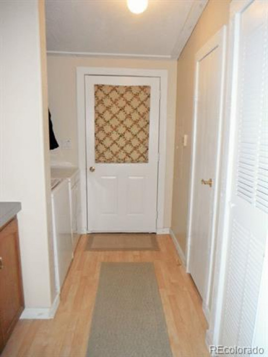 Main floor entry way, with cabinets for storage above washer dryer. Plus bonus utility sink and storage closet. Updated flooring as well.