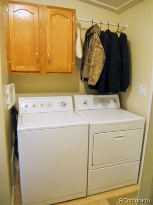 Washer and dryer with storage for all your cleaning supplies plus room to hang dry!