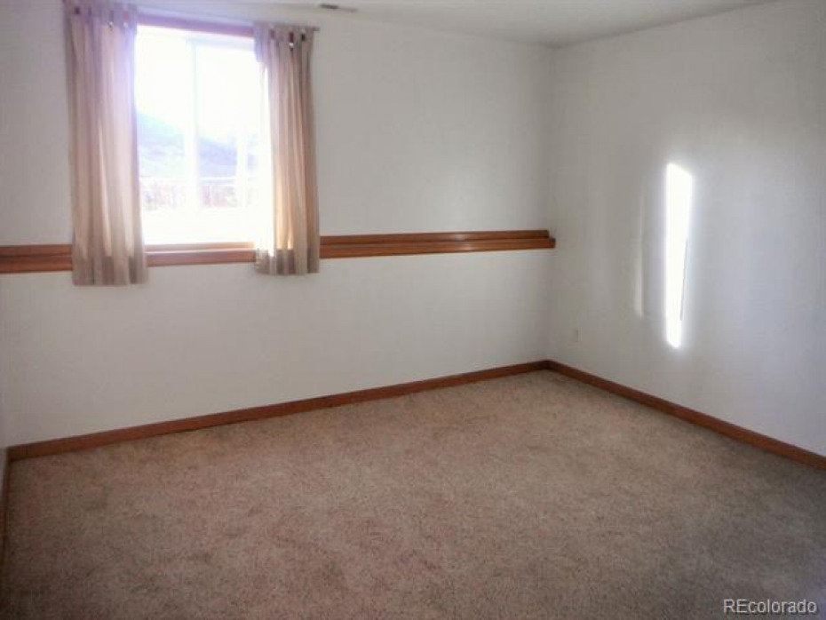 Bedroom #5, again a great sized room with tall ceilings and new carpet which is throughout the house.