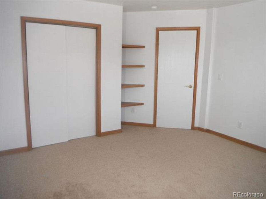 Bedroom #5 also has great storage from the large closet to the built in shelves.