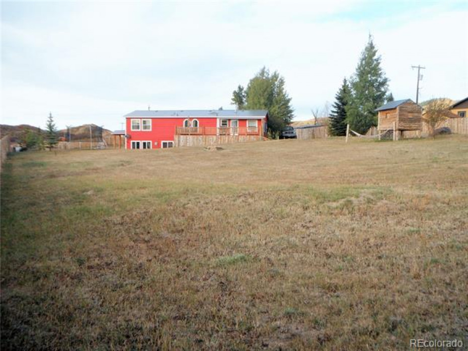 Great view of large backyard, which is completely fenced in, with kids clubhouse, over 1 acre of private space.