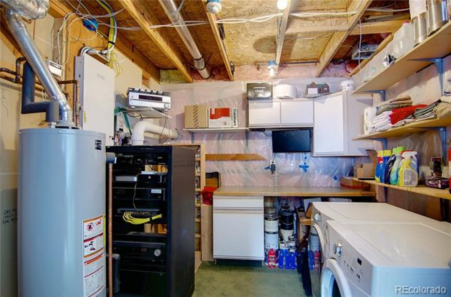 Laundry room with tons of storage space.