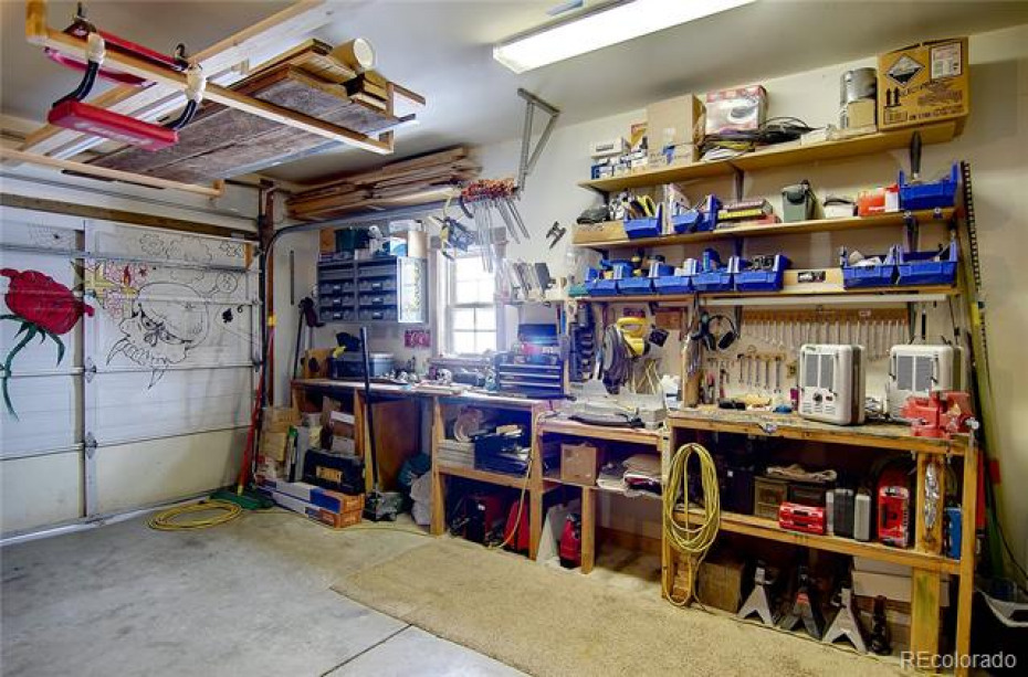 2 car garage with built in work bench and storage options