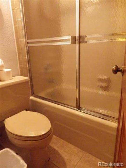 Upper level master bedroom, shower/toilet area.