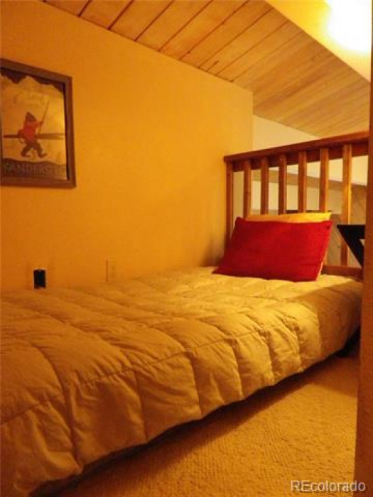 Main level bedroom with bunk beds.