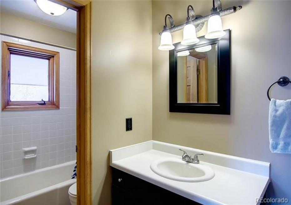 En suite bathroom for second bedroom (upper level).