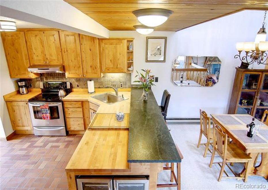 Nice view of the well appointed kitchen including a wine fridge.