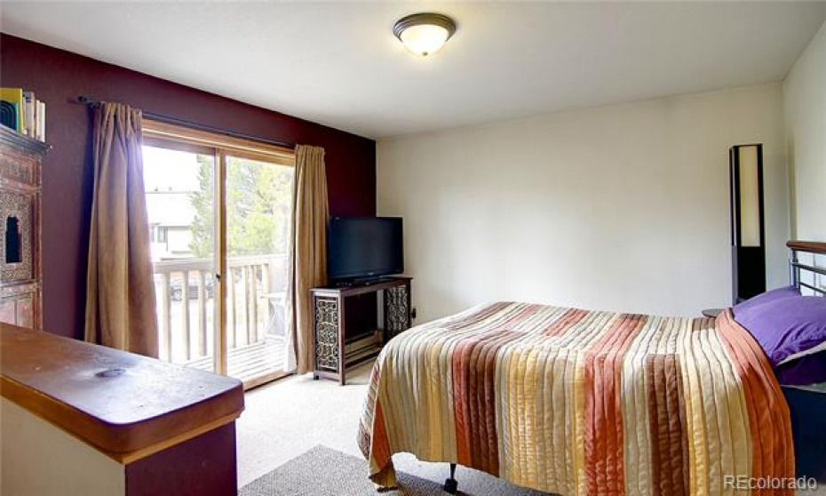 Third bedroom, located on main Level offering an en suite bathroom along with another private, covered deck!