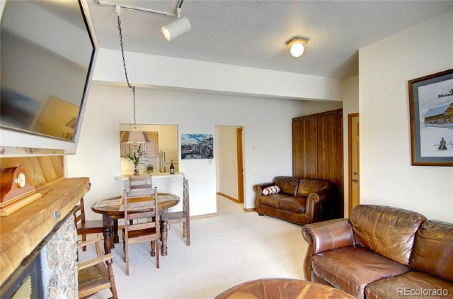 Rec Room Located on Basement Level with Murphy-Bed, Additional Storage Room, Full Bathroom and Private Patio!