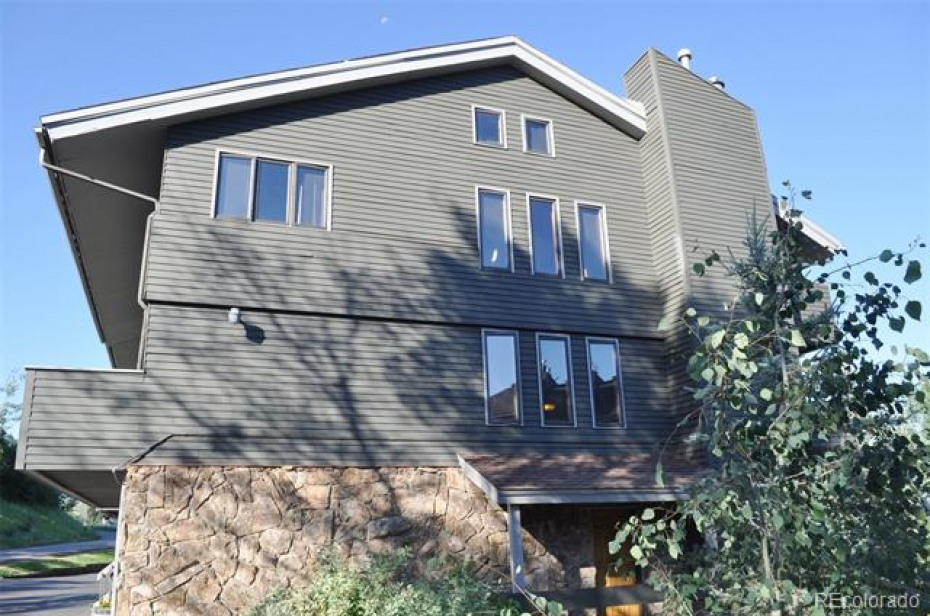 As an end unit, this townhome has three levels of additional windows, suffusing the home with natural light.