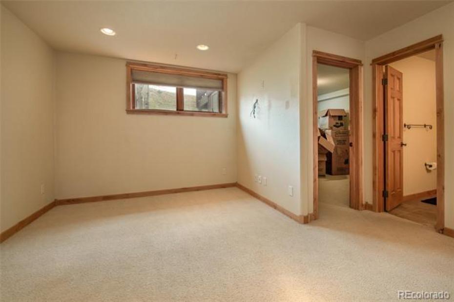 Downstairs den, bedroom and bathroom