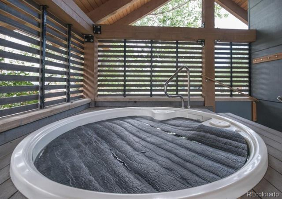 Enjoy the hot tub - covered to shed winter snow and summer rain.