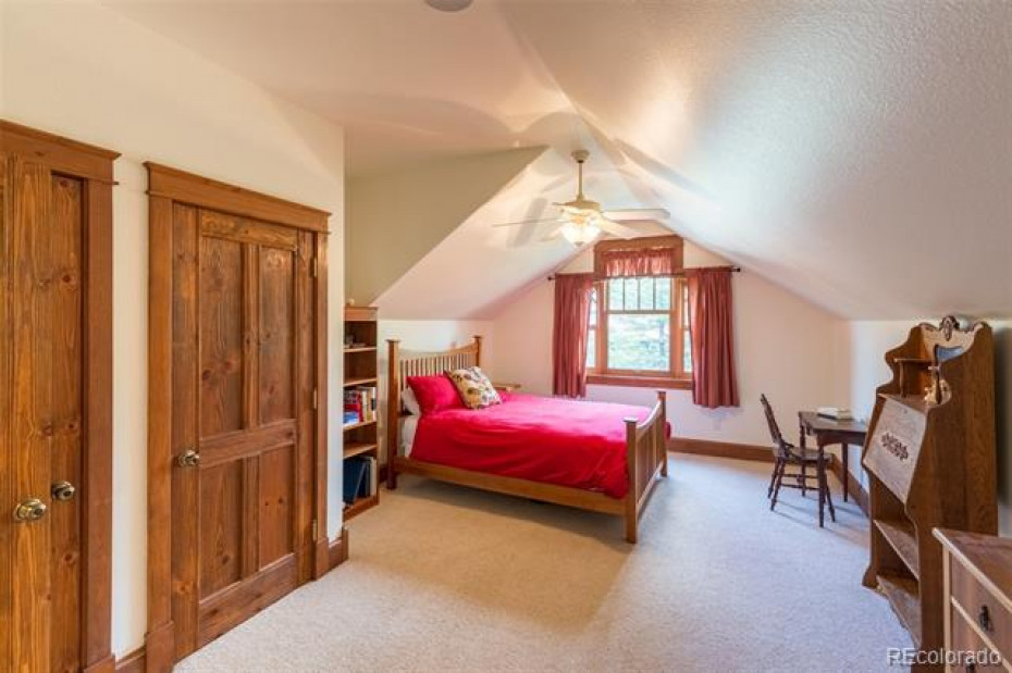 Large upstairs bedroom with mountain views