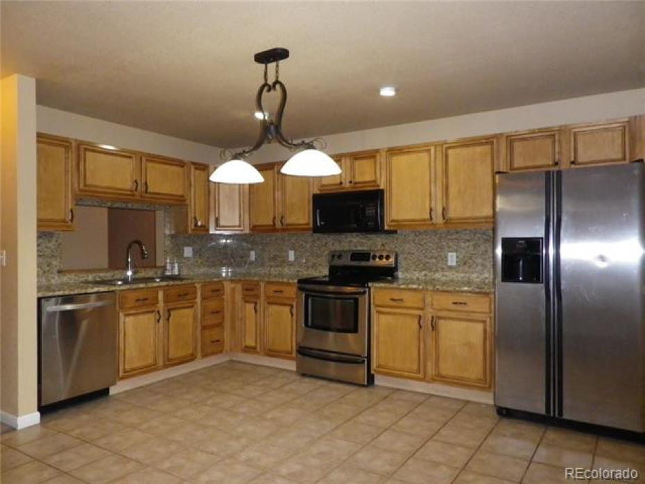 Large kitchen/dining room, with Stainless Steel appliances, and granite countertops.