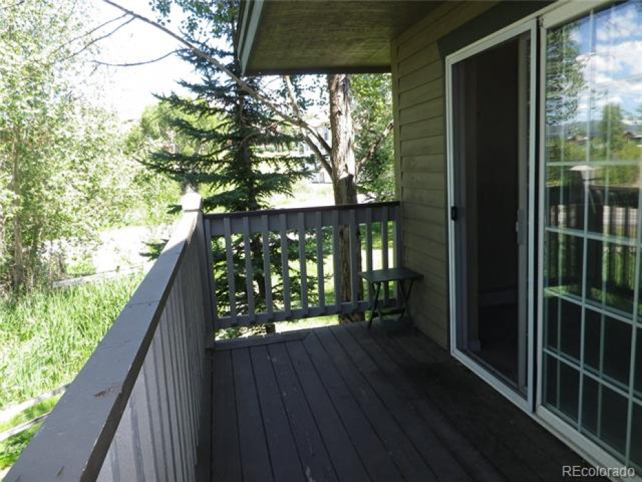 Private back deck with sliding glass door/screen door, from living room.   Great for BBQ grill and relaxing.