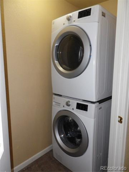 Stackable Washer and Dryer.  Main level, next to hallway bath.