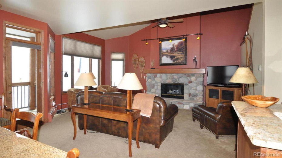 The gas log fireplace keeps it toasty in the winter, and provides a comfy spot to gather around.