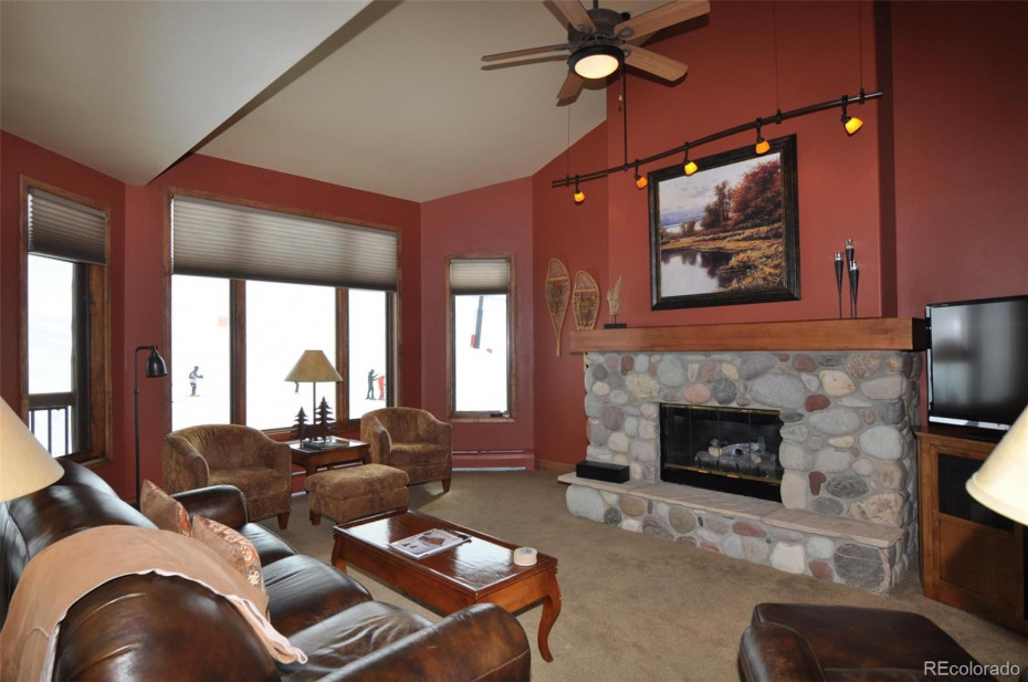 The vaulted ceiling provides a spacious feel, and the ceiling fan keeps the fresh mountain air moving.