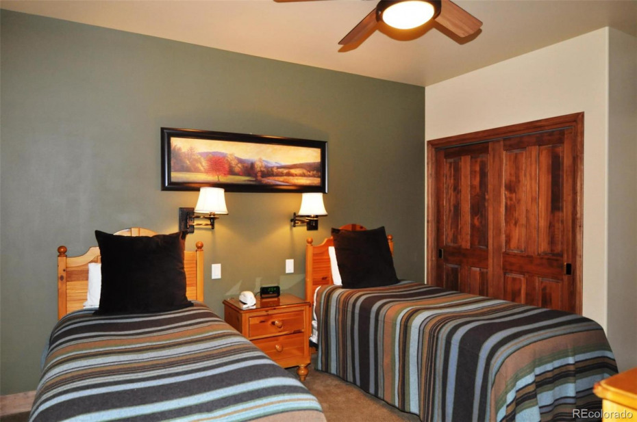 The third bedroom features twin beds and is on the upper level with the master bedroom.