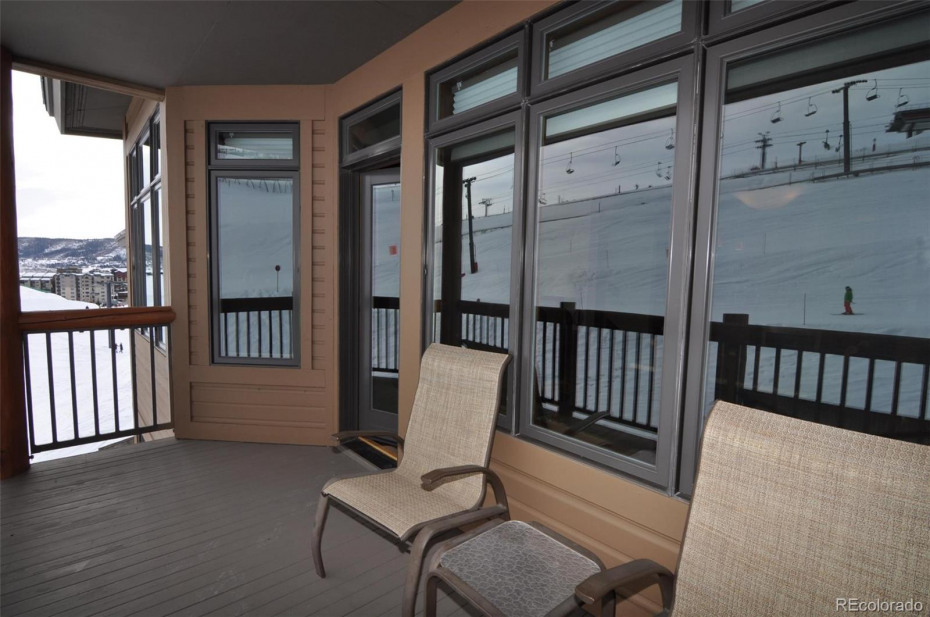 The covered balcony looks right on the slopes and since it is south-facing, perfect for morning coffee or an afternoon beverage.