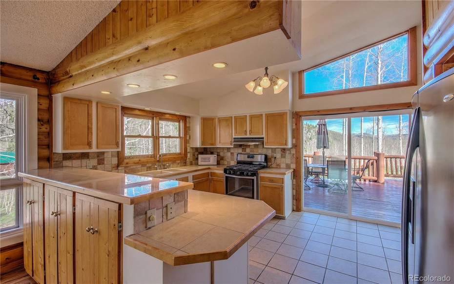 Bright open kitchen, thoughtful windows and plenty of counter space and storage!