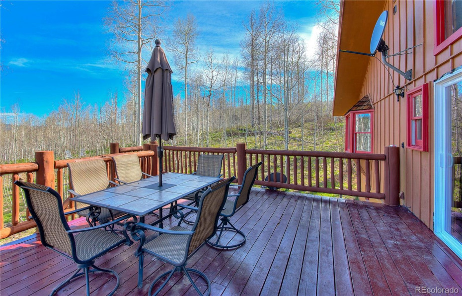 Enjoy this large back deck with privacy from your aspen grove.