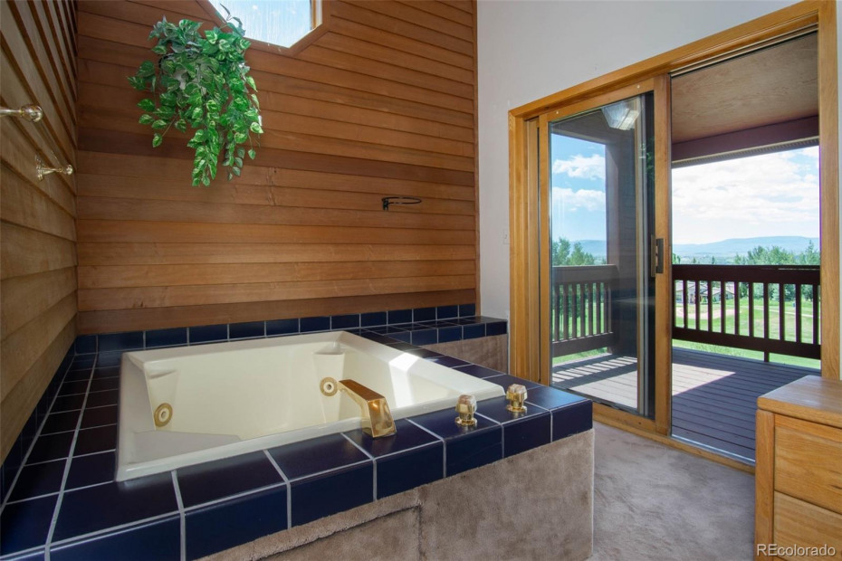 Jetted spa tub and deck - master bedroom.
