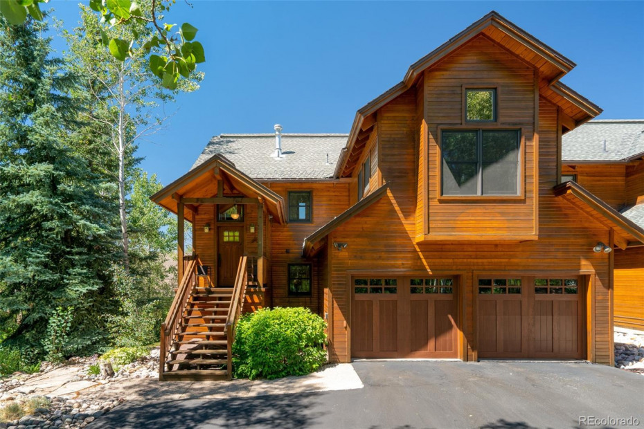 Entrance to Home with Mature Trees and Landscaping Providing Privacy and a Great Setting