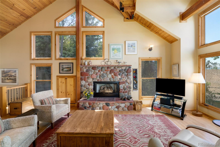 Vaulted Ceilings with Tongue and Grove finish accent the Riverrock Gas Fireplace in the Living/Great Room