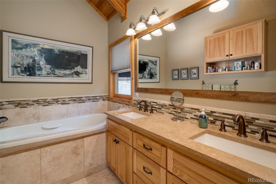 Master Bath with Ultra Bain Thermal Air Tub ( look it up, healthy and special) and travertine floors and counters