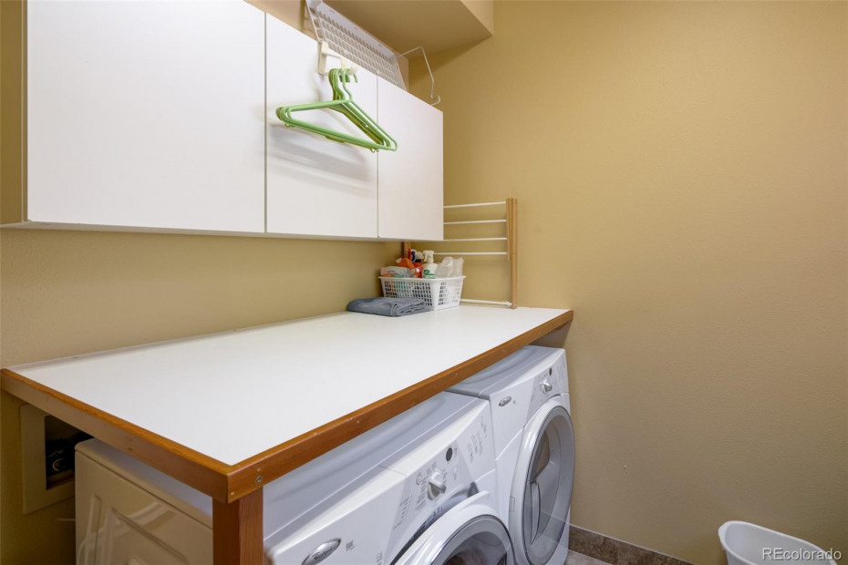 Laundry Room on Lower Level with window and cabinets