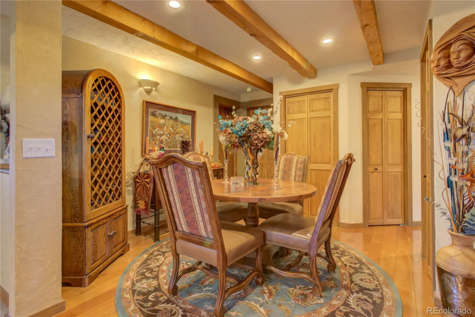 Upper Unit - Dining room.  Door to garage on far left.  Walk to right to enter Master suite