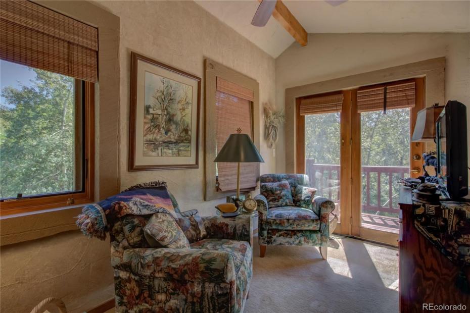 Upper Unit - Sitting area in master bedroom