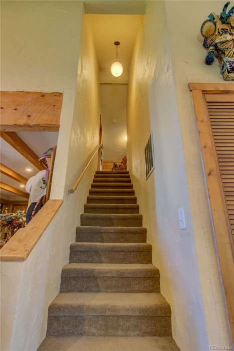 Upper Unit - stairs to upper bedrooms off living room