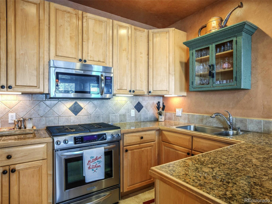 Granite and stainless with ample cabinet space.
