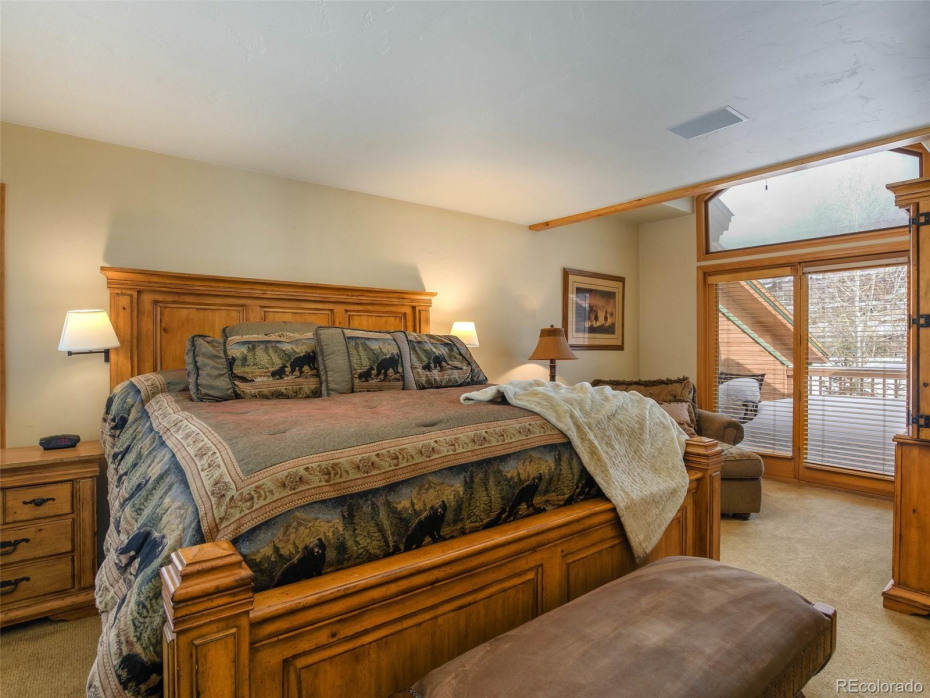 Spacious master with sitting area and private deck.