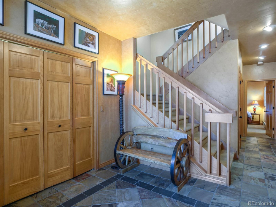 Large entry perfect for removing boots and coats. Tons of storage under the stairs for a big owner's closet.