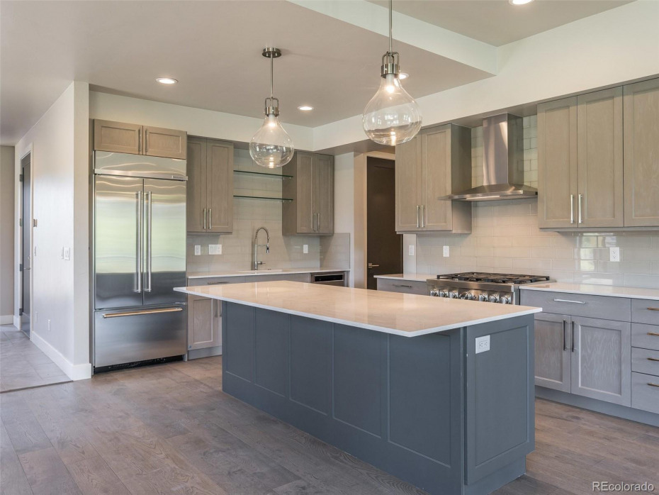 Mountain Traditional finishes and Upgraded appliances in Unit T1 (sold).