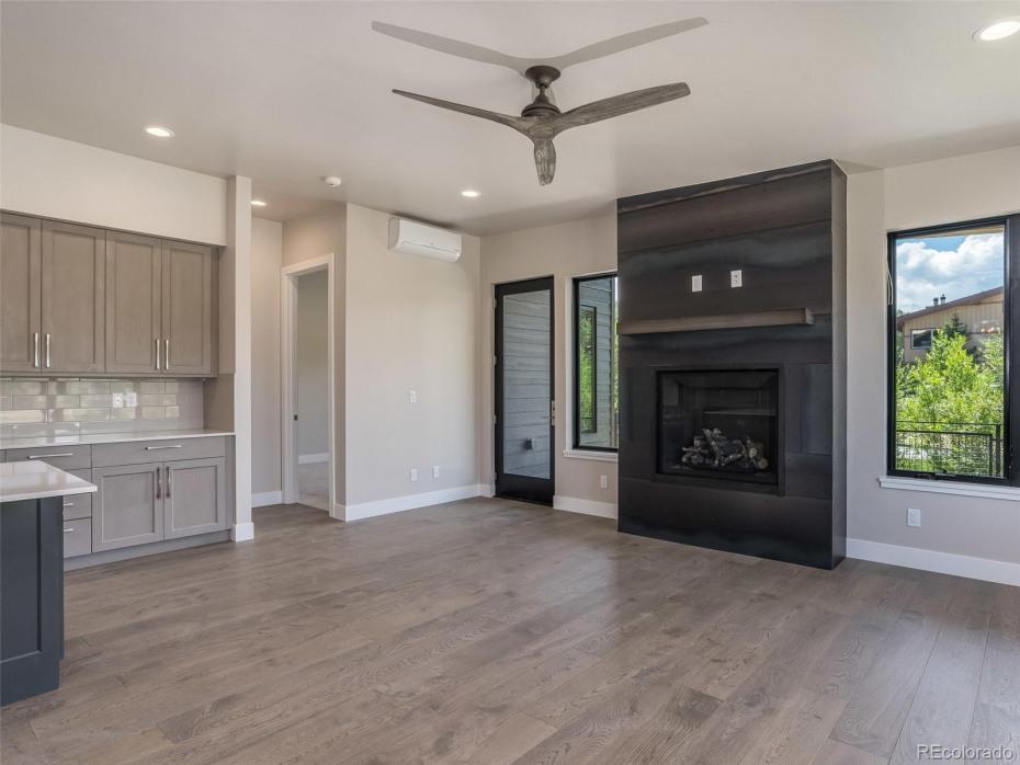 Mountain Traditional finishes and optional ceiling fan and steel mantel in Unit T1 (sold).